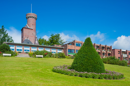 Bismarck Tower on Vogelsberg hill with the Ostseeblick Hotel in Luetjenburg at the Baltic Sea Stock Photo