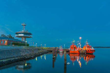 Pilot boat and control tower of the traffic center at the river mouth of the Trave river in Travemünde at the Baltic Sea