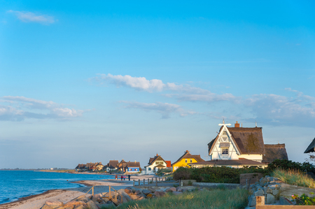 Nature reserve Graswarder with historical villas on the beach in Heiligenhafen at the Baltic Sea