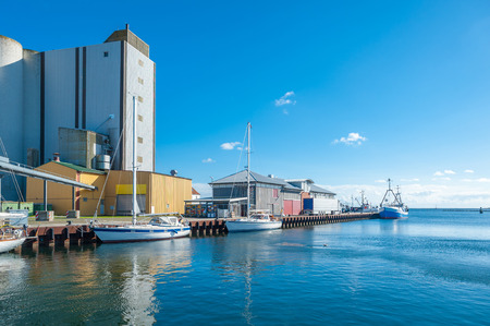 Fishing harbor with grain elevator in Burgstaaken at the Baltic Sea