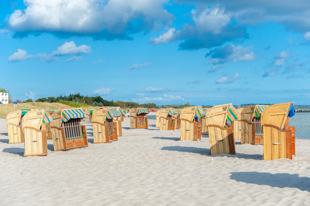 South beach with roofed wicker beach chairs in Burgtiefe at the Baltic Sea