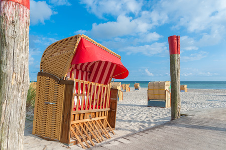 Roofed wicker beach chair at the South beach in Burgtiefe at the Baltic Sea