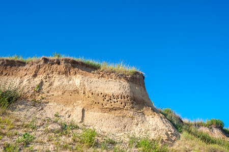 Cliff at the Wulfener Hals with breeding places for swallows on the island Fehmarn at the Baltic Sea