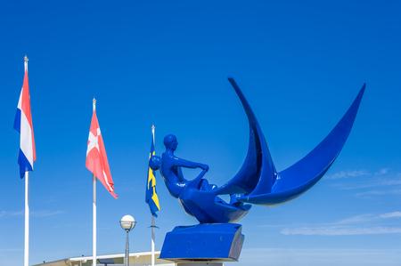 The sculpture Jollensegler in the marina of Groemitz at the Baltic Sea