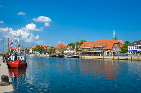 Townscape at the harbor of Neustadt in Holstein with traditional sailing ships and fishing boats