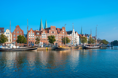 Historical cityscape with traditional sailing ships on the Untertrave river in L??¼beck at the Baltic Sea