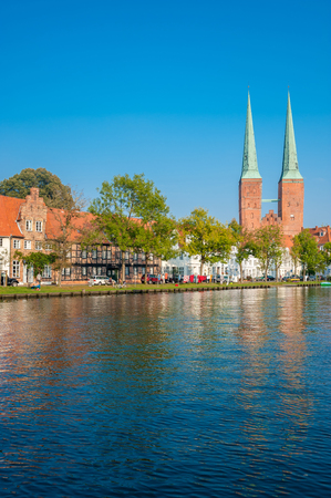 Historical cityscape at the river Trave with cathedral in Lubeck at the Baltic Sea Publikacyjne