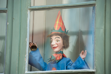 Clown Puppets in the window of the Museum of Theater Puppets Theater Museum in L??¼beck at the Baltic Sea Redactioneel