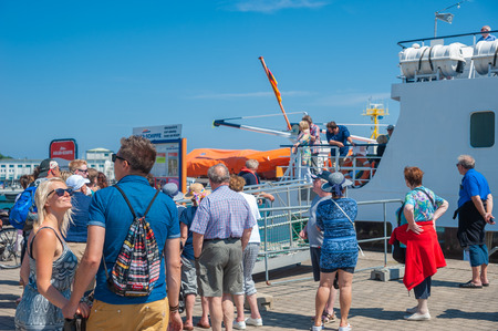 Tourists at the landing stage of a excursion boat at Sassnitz on the island of R?gen at the Baltic Sea