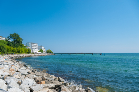 Promenade with pier and hotel Fürstenhof in Sassnitz on the island of Rügen at the Baltic Sea