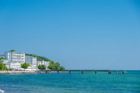 Pier with promenade and hotel Fürstenhof in Sassnitz on the island of Rügen at the Baltic Sea