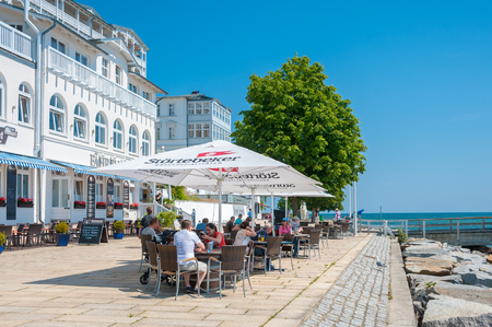 Promenade with restaurant and the hotel Fuerstenhof in Sassnitz on the island of Ruegen at the Baltic Sea