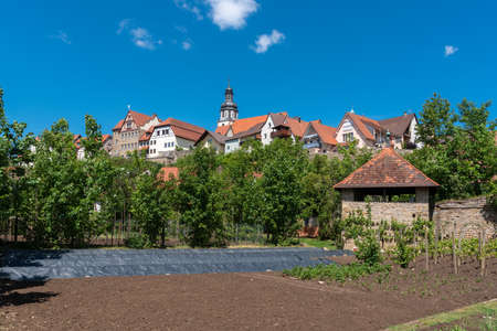City view with the historic city wall of Gochsheim and a view of St. Martin's Church. Gochsheim is a small town in the Kraichgau region of Germany