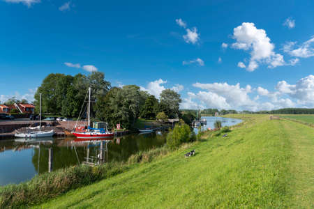 Landscape at the Hooksiler Binnentief. Hooksiel is a holiday resort in East Frisia and is located on the North Sea coast in Germany. Archivio Fotografico