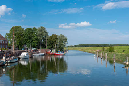 Sailboats in the Old Port of Hooksiel. Hooksiel is a holiday resort in East Frisia and is located on the North Sea coast in Germany.
