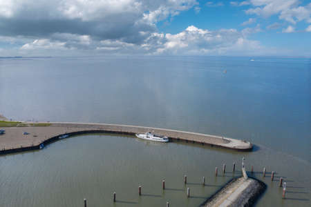 Aerial view of the harbor pier of Hooksiel and overlooking the Wadden Sea National Park. Hooksiel is a holiday resort in East Frisia and is located on the North Sea coast in Germany.