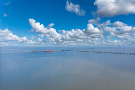 Aerial view of the landscape of the Wadden Sea National Park near Hooksiel. Hooksiel is a holiday resort in East Frisia and is located on the North Sea coast in Germany.