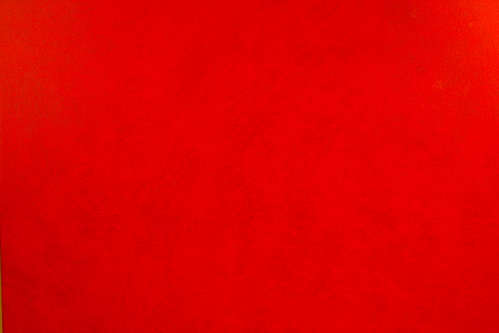 Red leather texture closeup, useful as background Stock Photo