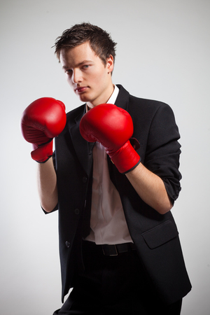 coporate: Businessman Wearing Boxing Gloves, On Gray Background