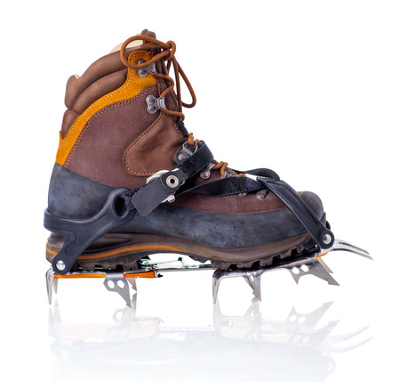 crampon: Boot with crampons isolated on white with reflection