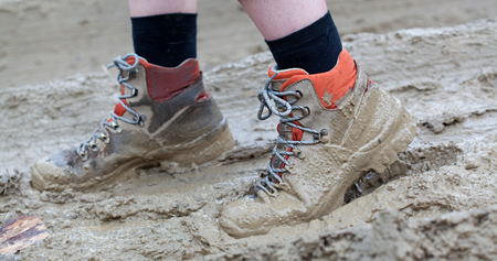 messy: Walking through thick messy mud Stock Photo