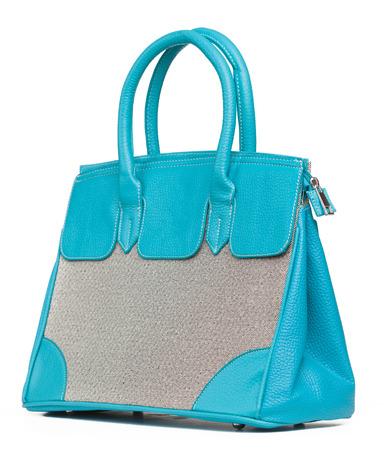 'hide out': Beautiful blue handbag on white