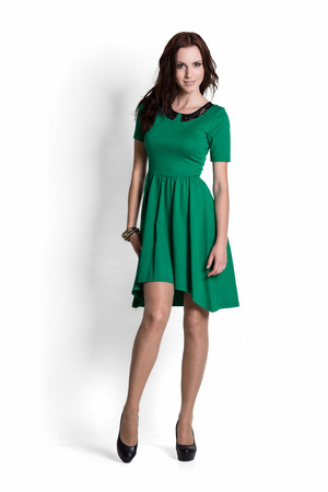 beautiful dress: Fashion model wearing green dress with emotions Stock Photo