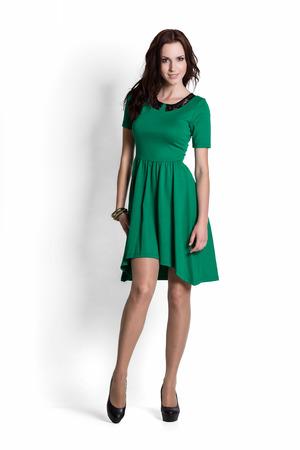 Mini skirt: Fashion model wearing green dress with emotions Stock Photo