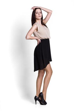 full shot: Glamour girl in dress on white Stock Photo