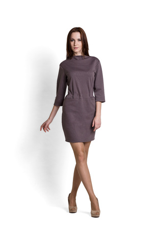 Fashion model wearing gray dress with emotions