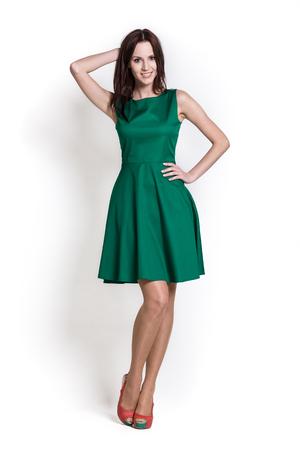 Glamour meisje in jurk op wit Stockfoto