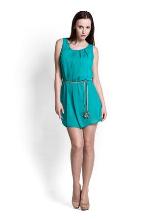 mini dress: Glamour girl in dress on white Stock Photo