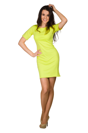 mini dress: Glamour girl in green dress on white