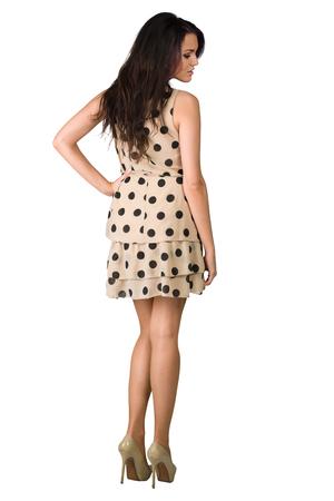 glamour girl: Glamour girl in polka-dot dress on white Stock Photo