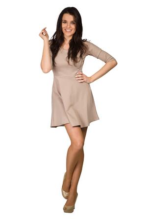 beauty full: Glamour girl in beige dress on white