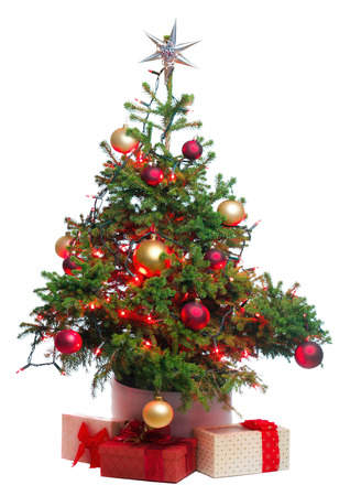 knack: Christmas tree with baubles and star ornaments and gifts. Stock Photo