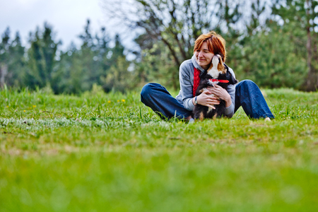 only teenage girls: A girl relaxing outside with her dog.