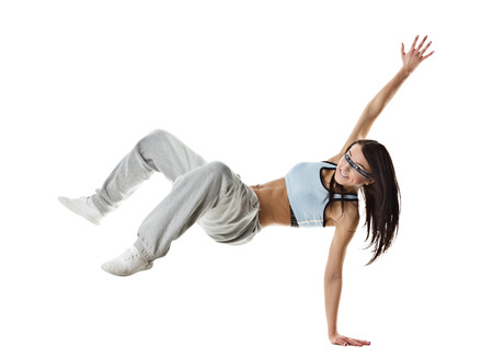 breakdancing: cool looking dancer posing on a grey background