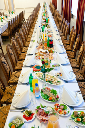buffet lunch: banquet meal trays served on tables Stock Photo