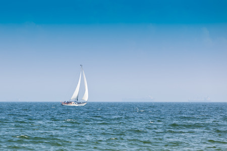 blu sky: Sailboat on the blue see and sky Stock Photo