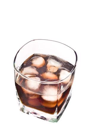 icecube: Smokey Whiskey on the Rocks on White Background. Stock Photo