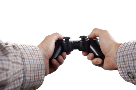 joypad: Hands holding a gamepad isolated on white.