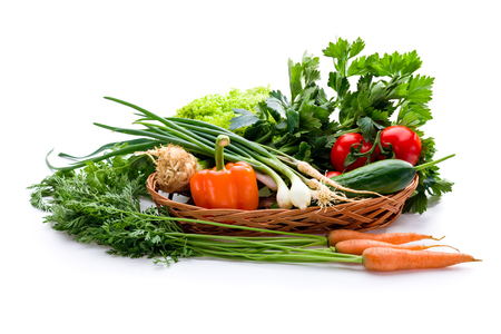 chinesse: Organic vegetables in basket on white background Stock Photo