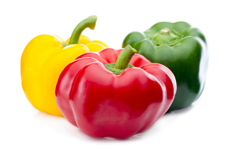 capsicum: Isolated sweet yellow bell pepper (Capsicum annuum) on white background.