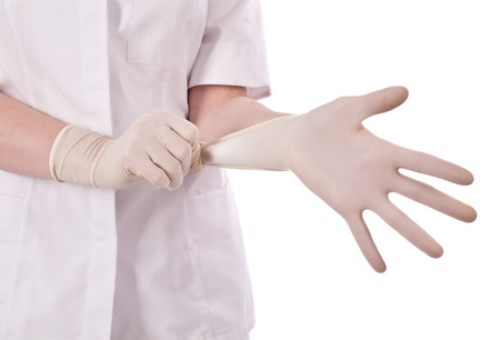 proctologist: Scientist put hand in gloves Stock Photo