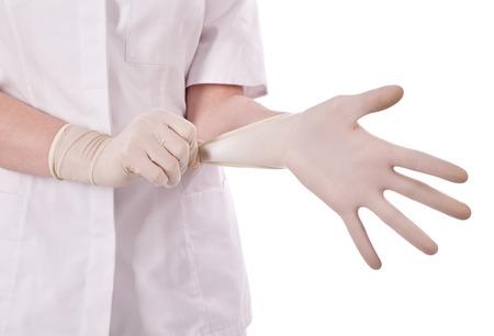 Scientist put hand in gloves Stock Photo