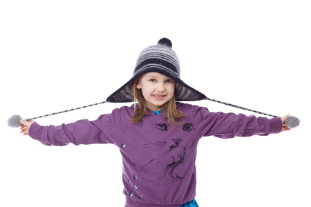 warm clothing: Happy girl wearing winter hat.