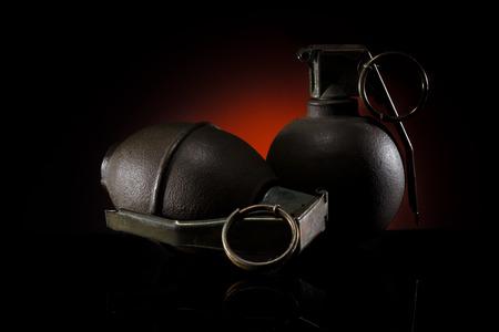 two hand grenades on dark background