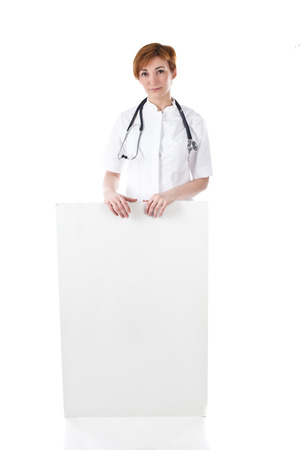 isolated sign: Female doctor holding a blank sign on white.
