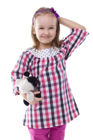 in loved: Little girl hugging her loved Teddy bear.